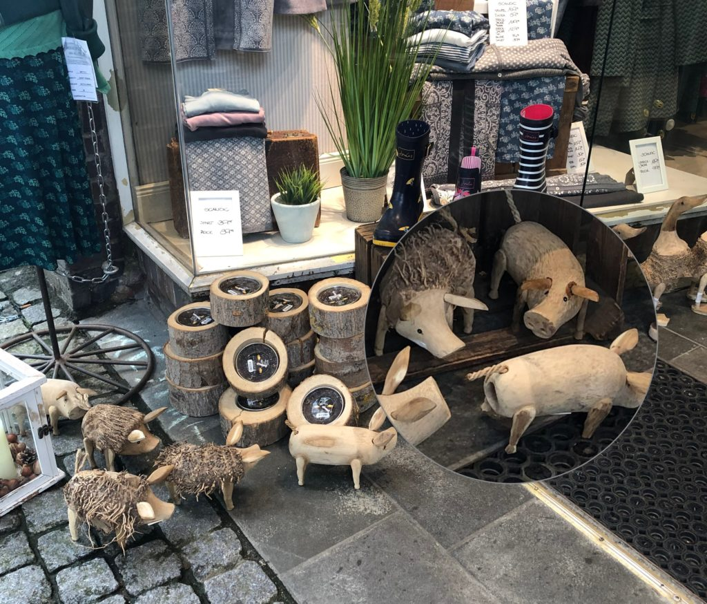 Some wooden miniature animals for sale in the street. Mini wooden pig in caption. Shopping tip!